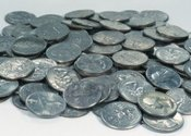 Main_thumb_14758458-pile-of-quarters-coins-on-grey-background
